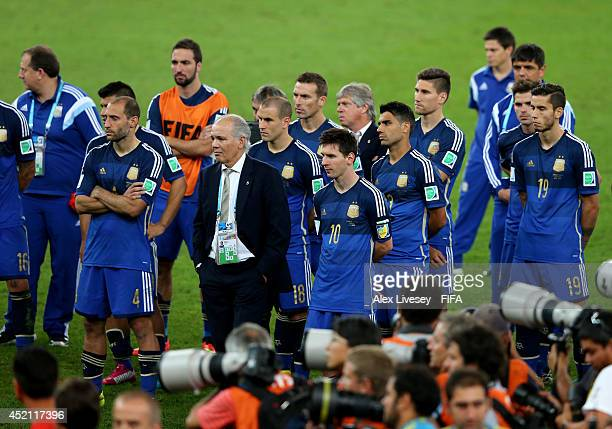 Head Coach Alejandro Sabella of Argentina Lionel Messi of Argentina and teammates show their dejection after the 2014 FIFA World Cup Brazil Final...