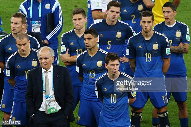 Head coach Alejandro Sabella of Argentina looks on with his team after being defeated by Germany 10 in extra time during the 2014 FIFA World Cup...