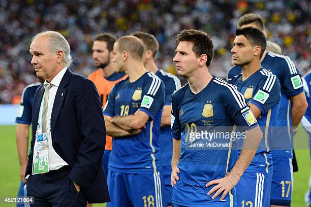 Head coach Alejandro Sabella of Argentina looks on with Lionel Messi after being defeated by Germany 10 in extra time during the 2014 FIFA World Cup...