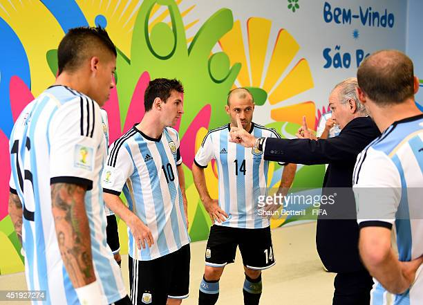 Head coach Alejandro Sabella of Argentina speaks to his players at the half time in the tunnel during the 2014 FIFA World Cup Brazil Semi Final match...