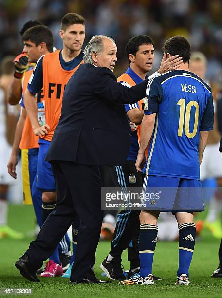 Head coach Alejandro Sabella of Argentina speaks to Lionel Messi during the 2014 FIFA World Cup Brazil Final match between Germany and Argentina at...