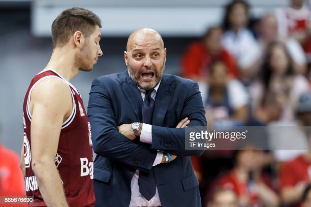Head Coach Aleksandar Sasa Djordjevic of Bayern Muenchen speak with Stefan Jovic of Bayern Muenchen during the easyCredit BBL Basketball Bundesliga...