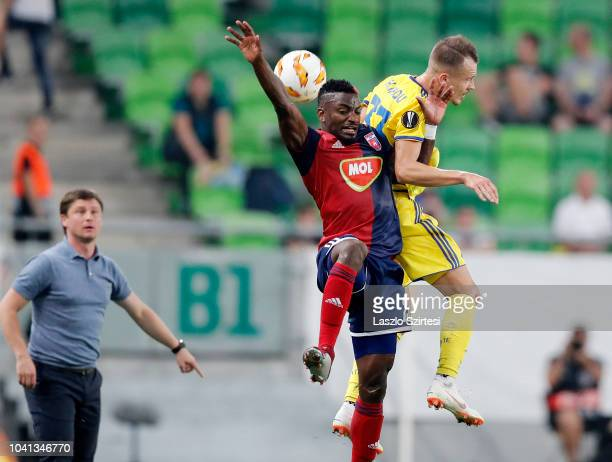 Head coach Aleksei Baga of FC BATE Borsiov washes the air battle between Ianique dos Santos Tavares 'Stopira' of Vidi FC and Denis Polyakov of FC...