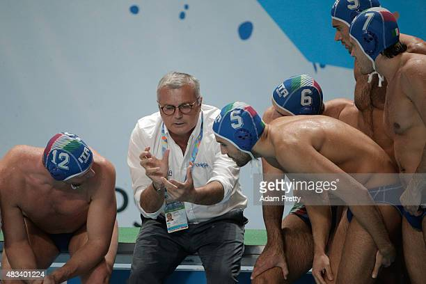 Head Coach Alessandro Campagna of Italy speaks to his players during the Men's bronze medal match between Greece and Italy on day fifteen of the 16th...
