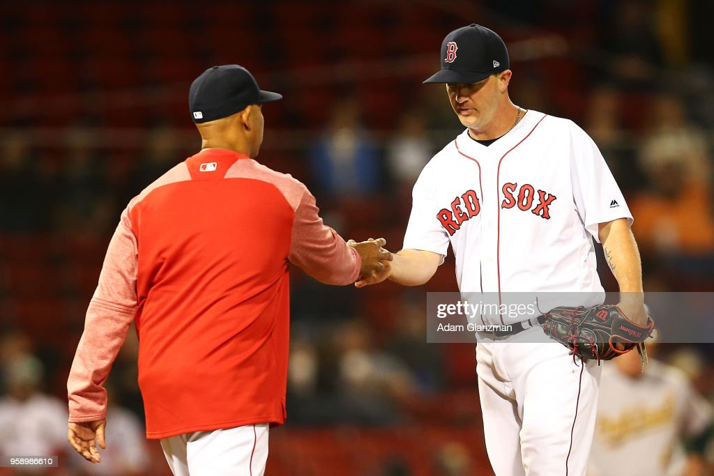 Head coach Alex Cora of the Boston Red Sox takes pitcher Steven Wright #35 out of the game in the eighth inning against the Oakland Athletics at Fenway Park on May 15, 2018 in Boston, Massachusetts.