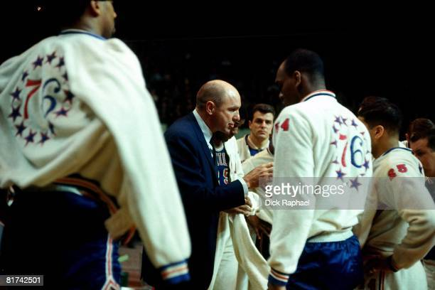 Head coach Alex Hannum of the Philadelphia 76ers talks to his team during a game played in 1967 against the Boston Celtics at the Boston Garden in...