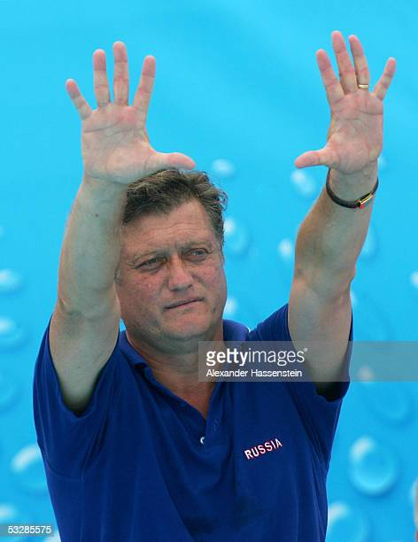 Head coach Alexander Kleymenov of Russia talks to his team in the quarterfinal match againts Italy at the XI FINA World Championships at the Parc...