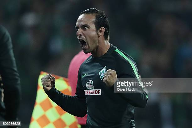 Head coach Alexander Nouri of Bremen celebrates after scoring during the Bundesliga match between Werder Bremen and 1 FSV Mainz 05 at Weserstadion on...