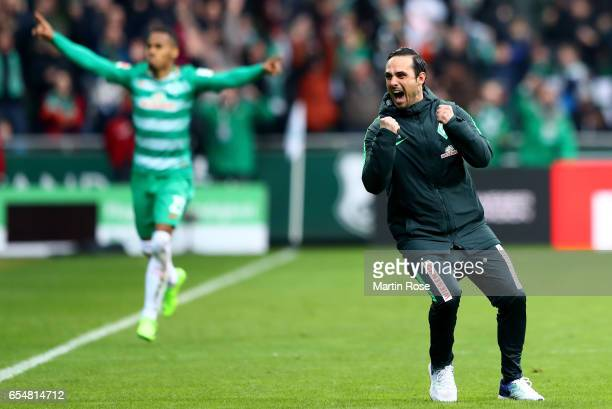 Head coach Alexander Nouri of Bremen celebrates after the third goal during the Bundesliga match between Werder Bremen and RB Leipzig at Weserstadion...