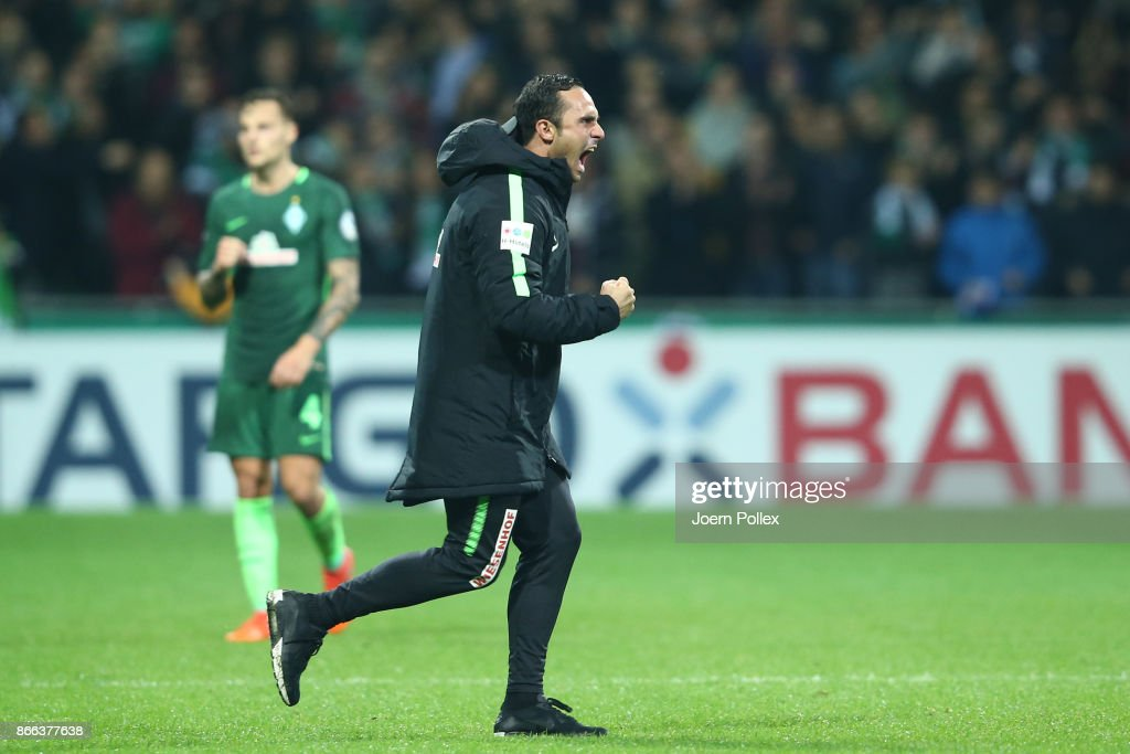 Head coach Alexander Nouri of Bremen celebrates after winning the DFB Cup match between Werder Bremen and 1899 Hoffenheim at Weserstadion on October 25, 2017 in Bremen, Germany.