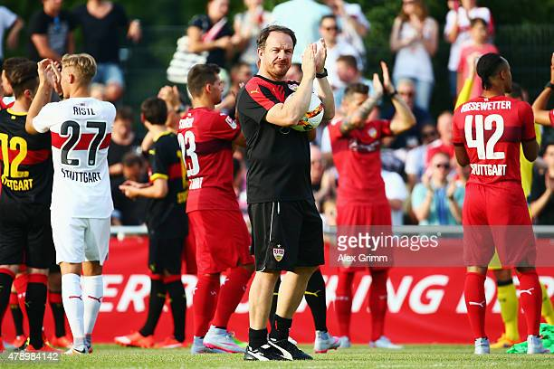 Head coach Alexander Zorniger applauds to the fans during the first training session of VfB Stuttgart at RobertSchlienzStadion on June 29 2015 in...