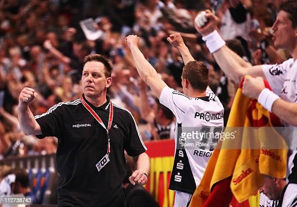 Head coach Alfred Gislason of Kiel celebrates during the Toyota Handball Bundesliga match between THW Kiel and HSV Hamburg at the Sparkassen Arena on...