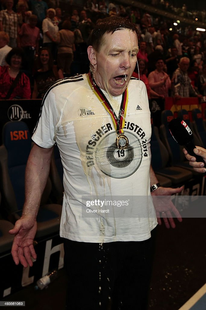 Head coach Alfred Gislason of Kiel has beer poured over him as they celebrate winning the DKB HBL Bundesliga match between THW Kiel and Fuechse Berlin on May 24, 2014 in Kiel, Germany.