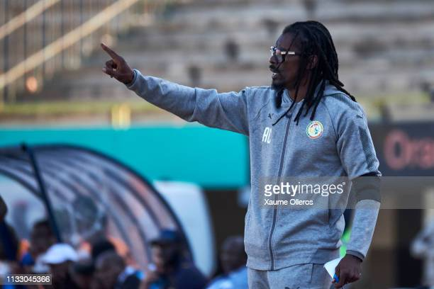 Head coach Aliou Cisse of Senegal gives instructions to his players during a friendly match between Senegal and Mali after both teams qualified for...
