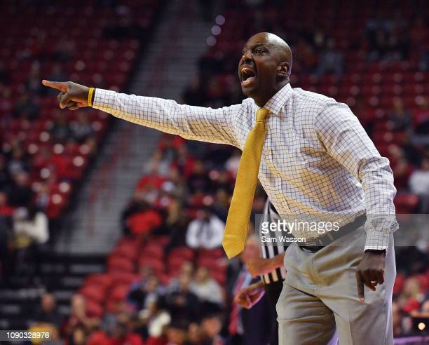Head coach Allen Edwards of the Wyoming Cowboys signals to his team during their game against the UNLV Rebels at the Thomas Mack Center on January 05...