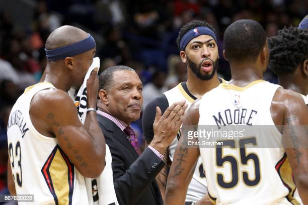 Head coach Alvin Gentry of the New Orleans Pelicans talks with his team during a time out against the Cleveland Cavaliers at the Smoothie King Center...
