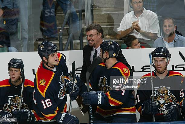 Head Coach and General Manager Rick Dudley of the Florida Panthers keeps his team motivated against the Tampa Bat Lightning during NHL action on...