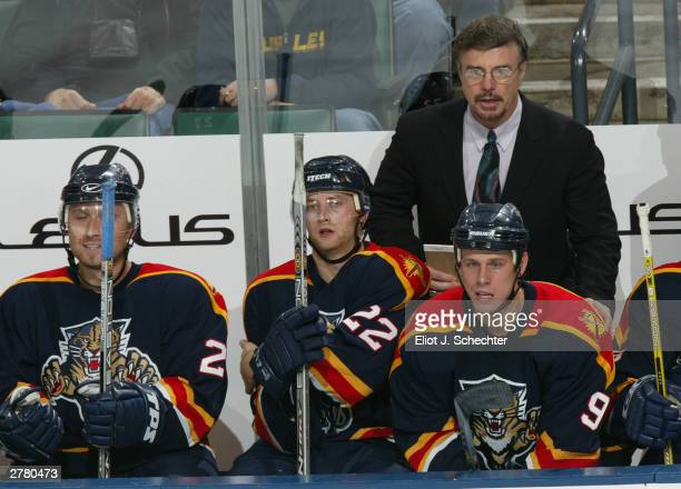 Head Coach and General Manager Rick Dudley of the Florida Panthers watches play against the Tampa Bay Lightning during NHL action on November 11 2003...