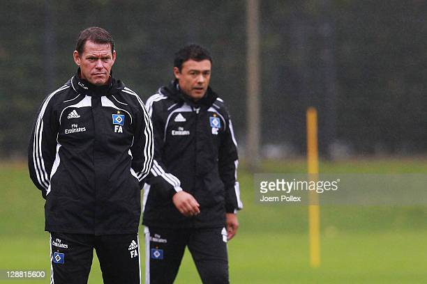 Head coach and sport director Frank Arnesen and assistent Rodolfo Cardoso of Hamburg are seen prior to a Hamburger SV training session on October 10...