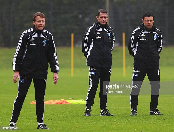 Head coach and sport director Frank Arnesen assistent Rodolfo Cardoso and assistent coach Frank Heinemann of Hamburg are seen prior to a Hamburger SV...