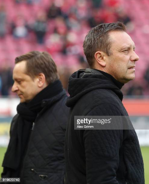 Head coach Andre Breitenreiter and sport director Horst Heldt of Hannover look on prior to the Bundesliga match between 1 FC Koeln and Hannover 96 at...