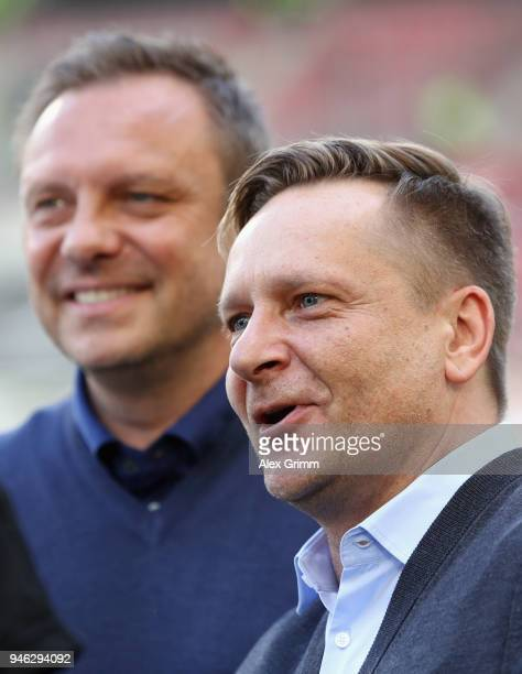 Head coach Andre Breitenreiter and sporting director Horst Heldt of Hannover look on prior to the Bundesliga match between VfB Stuttgart and Hannover...