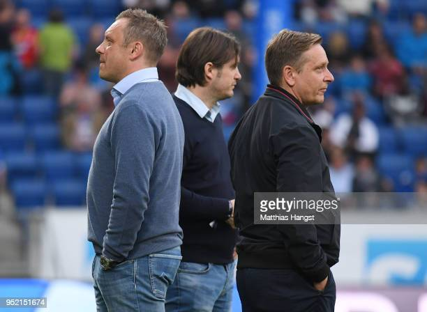 Head coach Andre Breitenreiter and sporting director Horst Heldt of Hannover look on prior to the Bundesliga match between TSG 1899 Hoffenheim and...