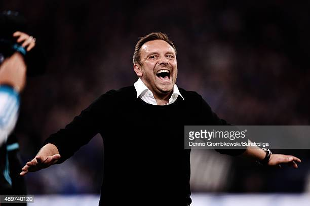 Head coach Andre Breitenreiter of FC Schalke 04 celebrates as Leroy Sane scores the second goal during the Bundesliga match between FC Schalke 04 and...