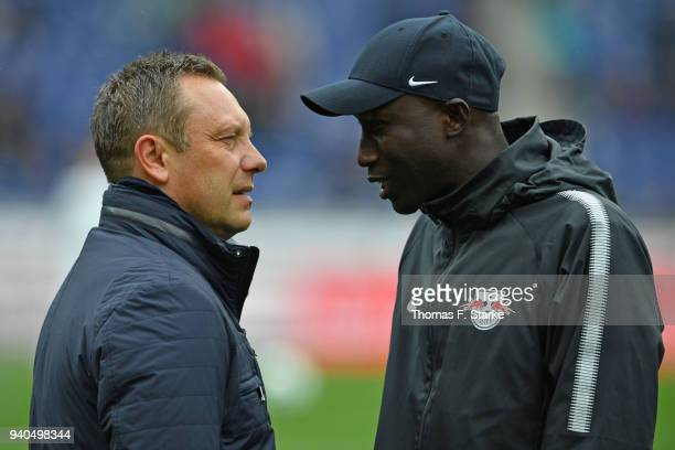 Head coach Andre Breitenreiter of Hannover and team manager Babacar N'Diaye of Leipzig chat prior to the Bundesliga match between Hannover 96 and RB...