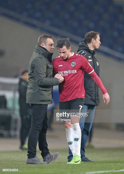 Head coach Andre Breitenreiter of Hannover speak with Edgar Prib of Hannover during the friendly match between Hannover 96 an FC Schalke 04 at...