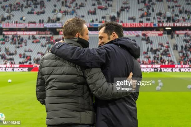 Head coach Andre Breitenreiter of Hannover speaks with Hasan Salihamidzic of Bayern Muenchen prior to the Bundesliga match between FC Bayern Muenchen...