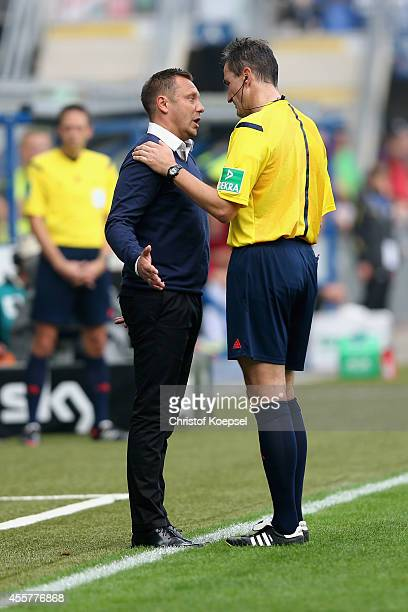 Head coach Andre Breitenreiter of Paderborn and referee Knut Kircher discuss during the Bundesliga match between SC Paderborn and Hannover 96 at...