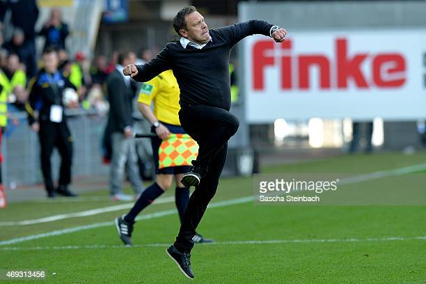 Head coach Andre Breitenreiter of Paderborn celebrates after winning the Bundesliga match against FC Augsburg at Benteler Arena on April 11 2015 in...