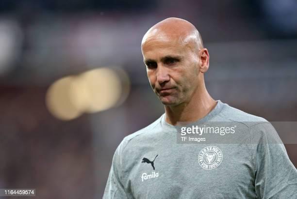 Head coach Andre Schubert of Holstein Kiel looks dejected during the Second Bundesliga match between FC St. Pauli and Holstein Kiel at...