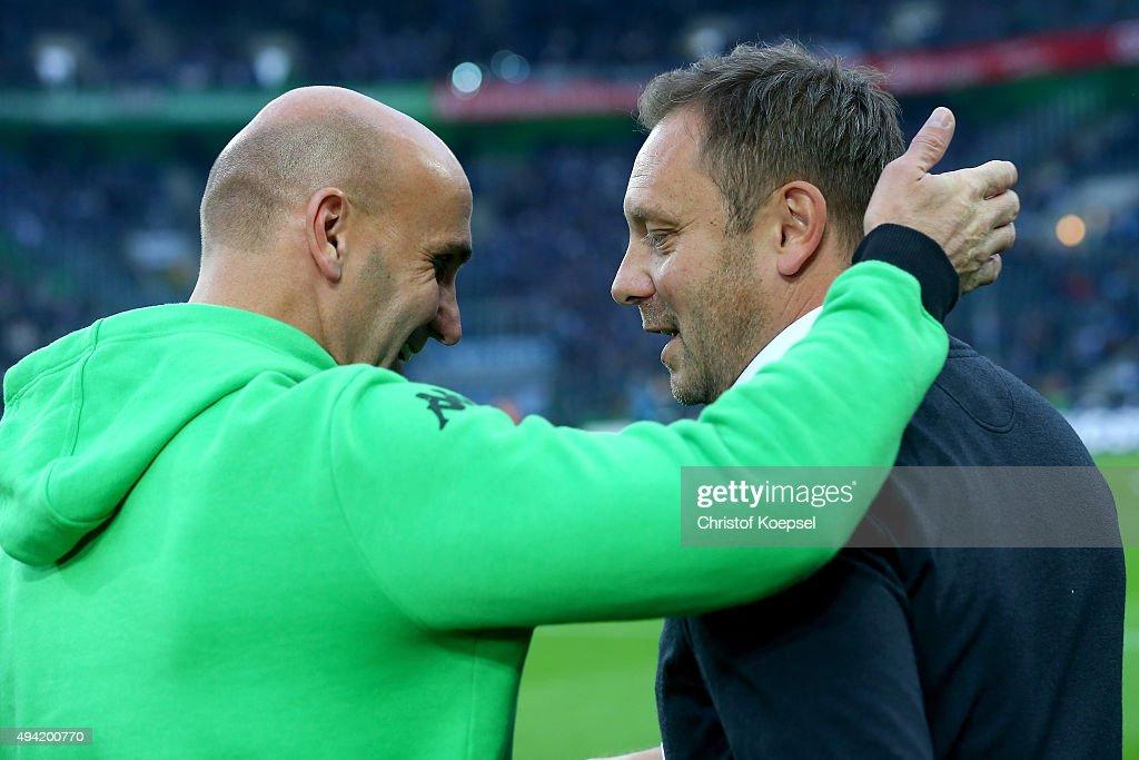 Head coach Andre Schubert of Moenchengladbach and head coach Andre Breitenreiter of Schalke talk prior to the Bundesliga match between Borussia Moenchengladbach and FC Schalke 04 at Borussia-Park on October 25, 2015 in Moenchengladbach, Germany.