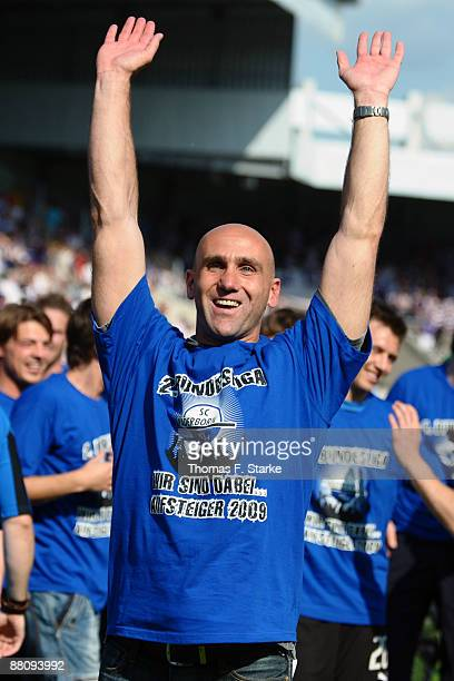 Head coach Andre Schubert of Paderborn celebrates the ascension to the Second Bundesliga after the Second Bundesliga Play Off match between VfL...