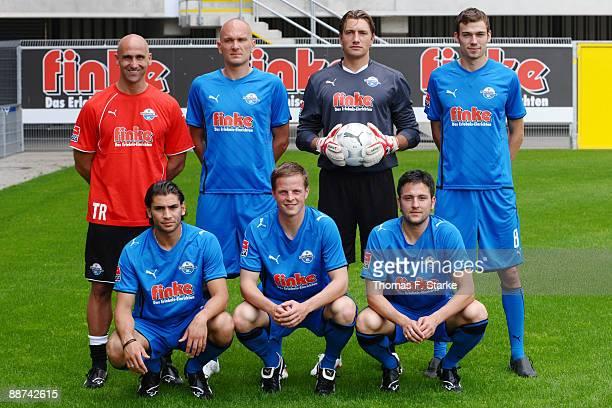 Head coach Andre Schubert poses with his new players Rudolf Zedi, Daniel Masuch, Sebastian Schachten Nejmeddin Daghfous, Philip Heithoelter and...