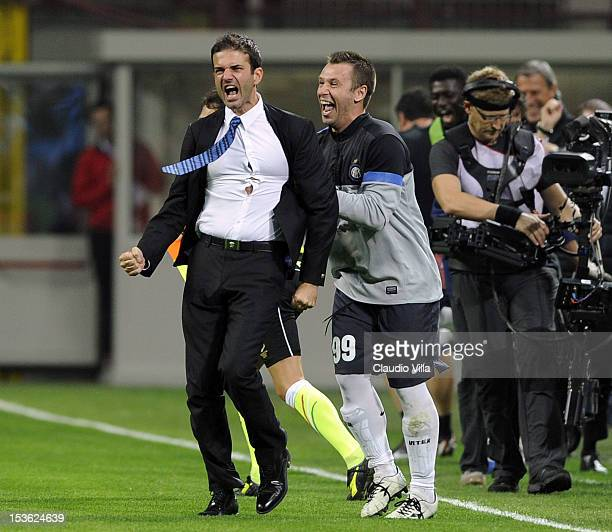 Head coach Andrea Stramaccioni of FC Inter Milan and Antonio Cassano celebrate victory at the end of the Serie A match between AC Milan and FC...