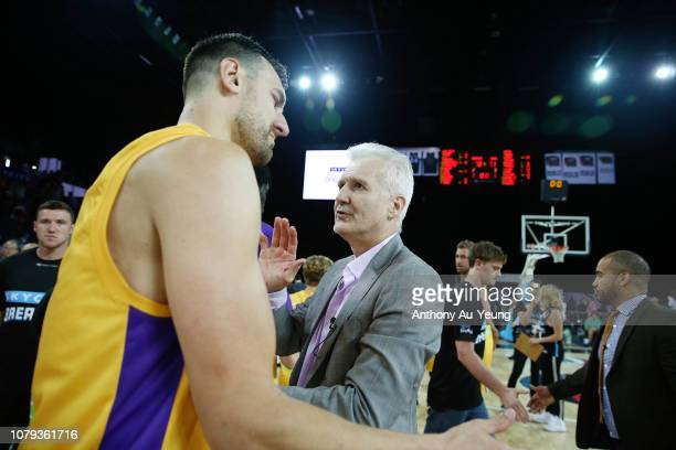 Head Coach Andrew Gaze of the Kings celebrates with Andrew Bogut after winning the round eight NBL match between the New Zealand Breakers and the...