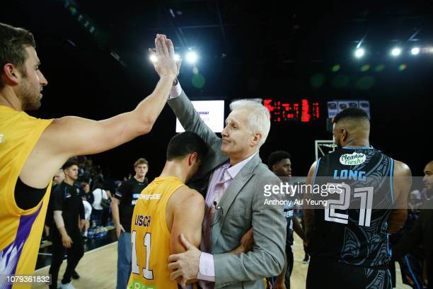 Head Coach Andrew Gaze of the Kings celebrates with the team after winning the round eight NBL match between the New Zealand Breakers and the Sydney...