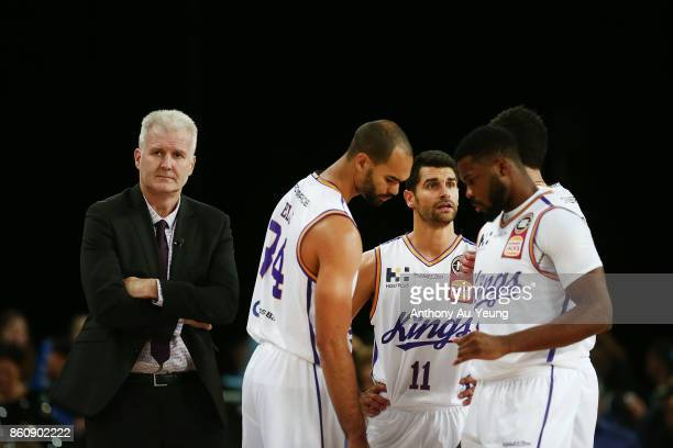 Head Coach Andrew Gaze of the Kings looks on with the team during the round two NBL match between the New Zealand Breakers and the Sydney Kings at...