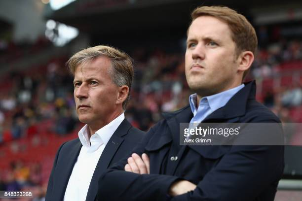 Head coach Andries Jonker and sport director Olaf Rebbe look on prior to the Bundesliga match between VfB Stuttgart and VfL Wolfsburg at MercedesBenz...