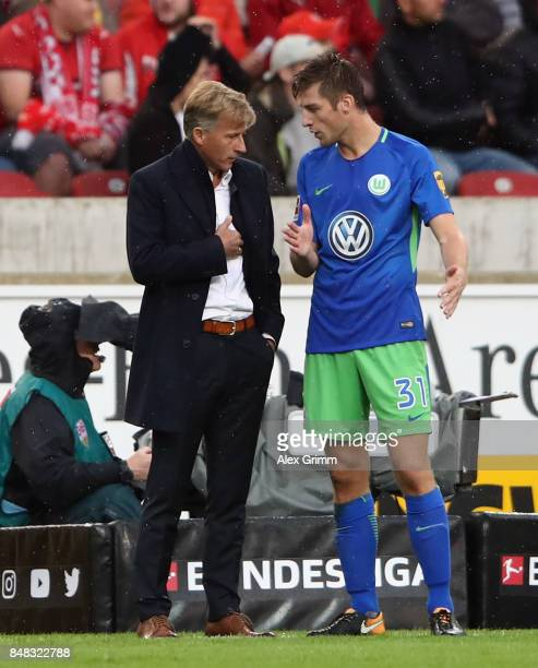 Head coach Andries Jonker of Wolfsburg talks to Robin Knoche during the Bundesliga match between VfB Stuttgart and VfL Wolfsburg at MercedesBenz...