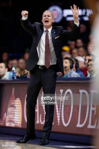 Head coach Andy Enfield of the USC Trojans gestures during the first half of the college basketball game against the Arizona Wildcats at McKale...