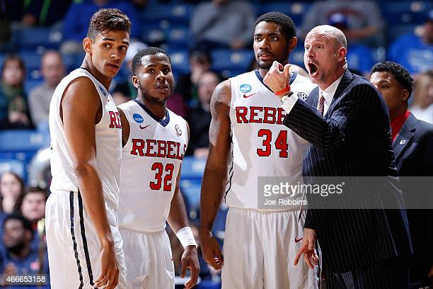 Head coach Andy Kennedy of the Mississippi Rebels speaks with his players against the Brigham Young Cougars during the first round of the 2015 NCAA...