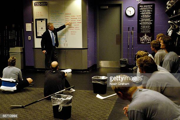 Head coach Andy Murray of the Los Angeles Kings talks to his players in the locker room before their preseason game against the Mighty Ducks of...