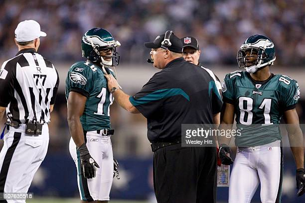 Head Coach Andy Reid and Jeremy Maclin of the Philadelphia Eagles talk on the sidelines during a game against the Dallas Cowboys at Cowboys Stadium...