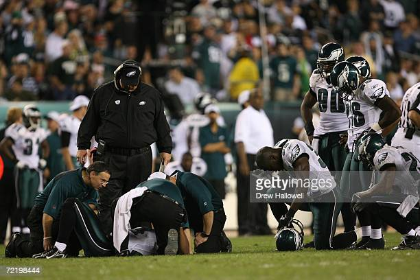 Head coach Andy Reid and members of the Philadelphia Eagles watch over an injured Sheldon Brown being checked by training staff during the game...