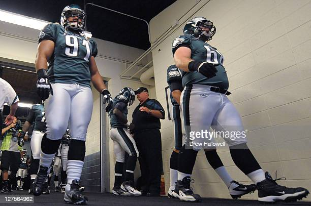 Head coach Andy Reid and Michael Vick of the Philadelphia Eagles talk in the tunnel before the game against the New York Giants at Lincoln Financial...