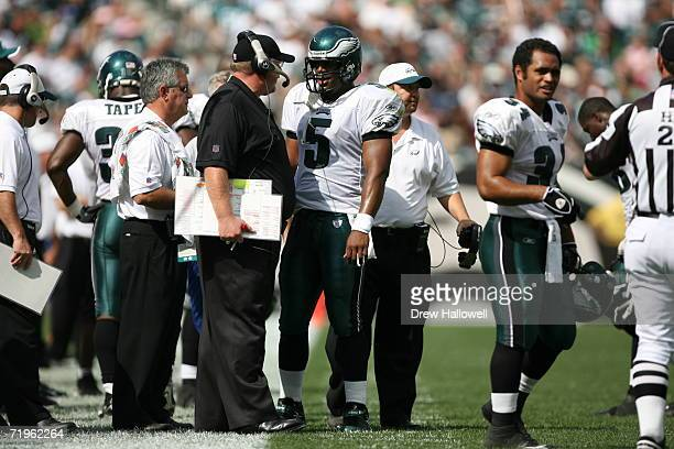 Head coach Andy Reid and Quarterback Donovan McNabb of the Philadelphia Eagles have a discussion on the sideline during the game against the New York...